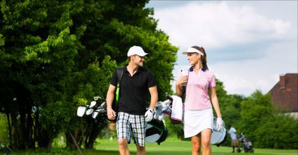 couple with golf equipment