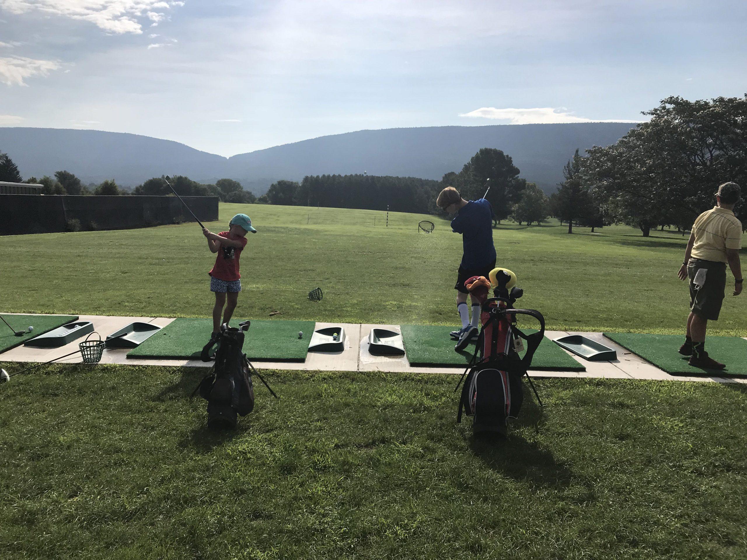 Junior golfers on the driving range