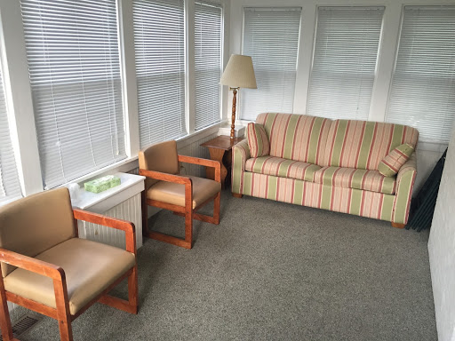 striped couch and chairs
