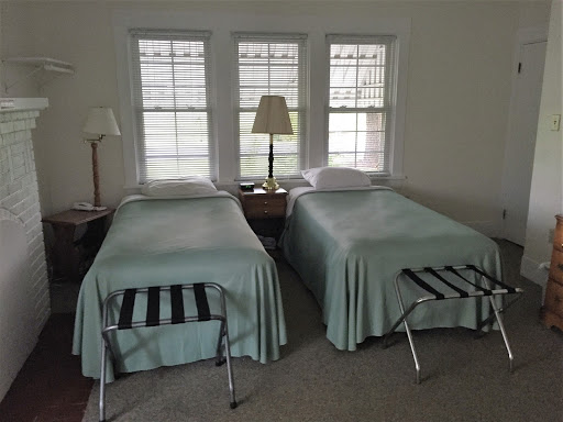 two twin beds with green comforters